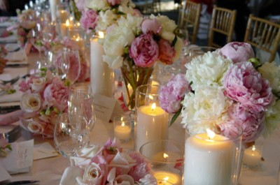 Peonies, roses and candles centrepiece