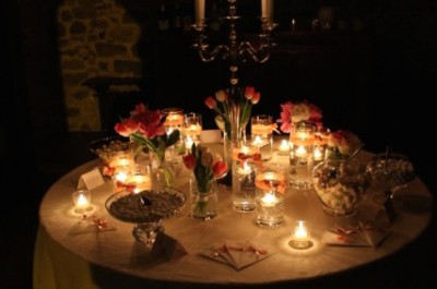 Table with fancy sweet-boxes and candles